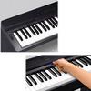 Controles del piano y tarjeta de memoria.